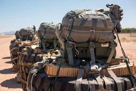 Joint Precision Airdrop Systems are secured to palletized gear and staged to be loaded on to a C-130 Hercules aircraft during Weapons and Tactics Instructor Course on Marine Corps Air Station Yuma, Ariz., March 30, 2017. The JPADS use GPS, a modular autonomous guidance unit, a parachute and electric motors to guide cargo to their targeted drop zones. (U.S. Marine Corps photo by Lance Cpl. Roderick Jacquote)