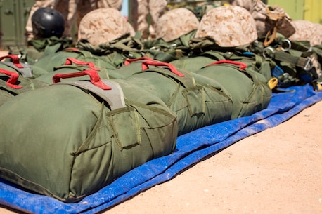 Parachutes are set and ready for use by U.S. Marines during Weapons and Tactics Instructor Course 2-17 on Marine Corps Air Station Yuma, Ariz., March 30, 2017. The parachutes are used as reserves in case the primary parachutes malfunction during static line parachuting. Static line parachute training is used to develop Marines' efficiency with the equipment. The Marines were with Landing Support Company, 1st Transportation Support Battalion, 1st Marine Logistics Group and Landing Support Company, 2nd TSB, 2nd MLG. (U.S. Marine Corps photo by Lance Cpl. Roderick Jacquote)