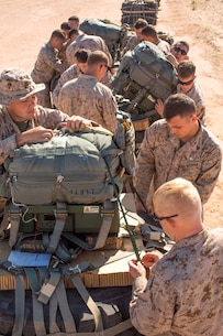 U.S. Marines prepare Joint Precision Airdrop Systems for flight during Weapons and Tactics Instructors Course 2-17 on Marine Corps Air Station, Yuma, Ariz., March 30, 2017. The JPADS uses GPS, a modular autonomous guidance unit, a parachute and electric motors to guide cargo to their targeted drop zones. The Marines were with Landing Support Company, Transportation Support Battalion, Combat Logistics Regiment 1, 1st Marine Logistics Group and Landing Support Company, 2nd TSB, CLR- 2, 2nd MLG. (U.S. Marine Corps photo by Lance Cpl. Roderick Jacquote)