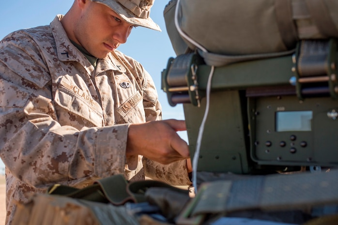 U.S. Marine Pfc. Brad Clark adjusts the settings on a Joint Precision Airdrop System during Weapons and Tactics Instructors Course 2-17 on Marine Corps Air Station, Yuma, Ariz., March 30, 2017. The JPADS uses GPS, a modular autonomous guidance unit, a parachute and electric motors to guide cargo to their targeted drop zones. Clark is an air delivery specialist with Landing Support Company, 2nd Transportation Support Battalion, Combat Logistics Regiment 2, 2nd Marine Logistics Group. (U.S. Marine Corps photo by Lance Cpl. Roderick Jacquote)