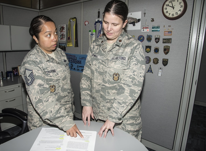 Master Sgt. Ninanona Payongayong, 42nd Air Base Wing Inspector General Superintendent, and Maj. Elaine Maxwell, 42nd ABW Inspector General Complaints Resolution director, look over Maxwell's Unit Effectiveness Inspection results, April 13, 2017, Maxwell Air Force Base, Ala. Maxwell received a rating an effective, on a scale of, highly effective, effective, marginally effective and ineffective. (U.S. Air Force photo/ Senior Airman Alexa Culbert)