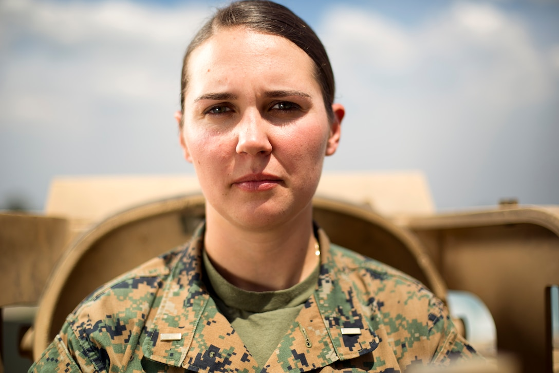 Second lieutenant Lillian Polatchek poses in front of an M1A1 Abrams tank at Fort Benning, Georgia. Polatchek is the first female Marine Tank Officer after graduating as the distinguished honor graduate of her Army's Armor Basic Officer Leaders Course on April 12, 2017.