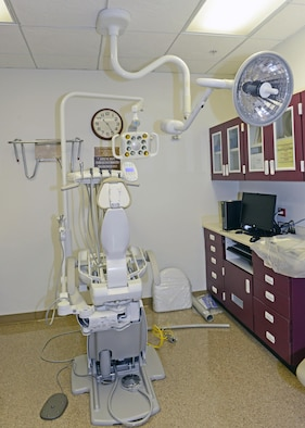 One of 15 new A-dec 500 dental chairs sits in a dental room after being fully unpacked. Clinic officials say the new chairs will provide better comfort and function for patient and dental staff. (U.S. Air Force photo by Kenji Thuloweit)
