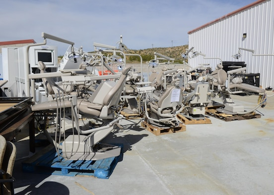 The old dental chairs sit in a lot behind the Main Clinic and will be shipped to the Defense Reutilization and Marketing Office at a later date. (U.S. Air Force photo by Kenji Thuloweit)