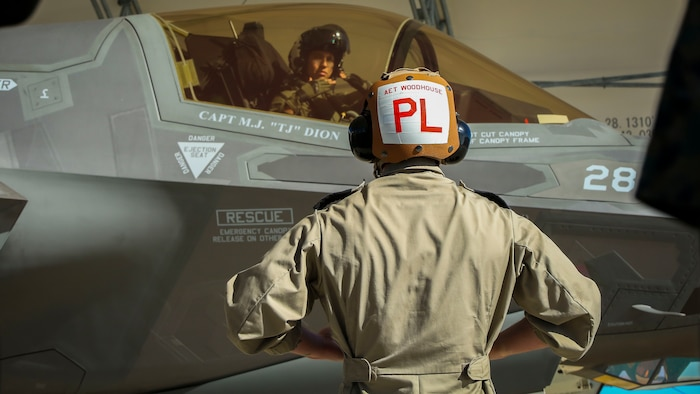 An F-35B Lightning II maintainer initiates pre-flight checks aboard Marine Corps Air Station Beaufort, April 11. The F-35B pilot instructors are training with Joint Direct Attack Munitions. After the instructors are proficient with JDAM they will add the ordnance to the syllabus for the F-35B training pilot program. The maintainer is with the United Kingdom.