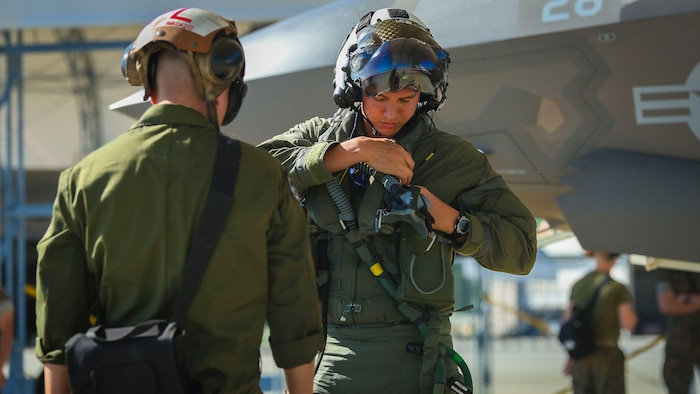 Maj. Jesse Peppers prepares his flight gear aboard Marine Corps Air Station Beaufort, April 11. Peppers and the other F-35B Lightning II pilot instructors are training with Joint Direct Attack Munitions. After the instructors are proficient with JDAM they will add the ordnance to the syllabus for the F-35B training pilot program. Peppers is with Marine Fighter Attack Training Squadron 501, Marine Aircraft Group 31.