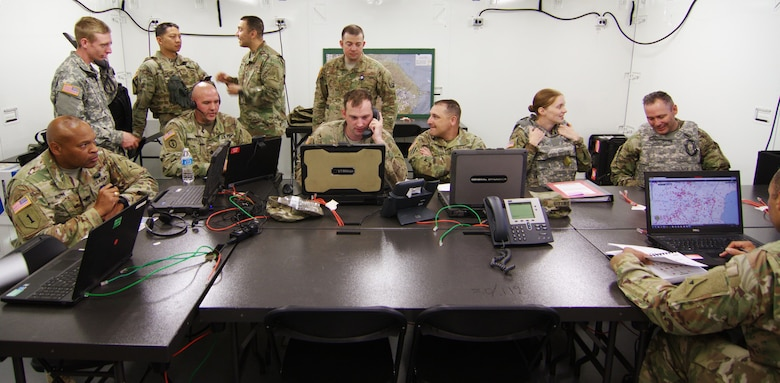 U.S. Airmen and Soldiers work together in the command post during Warfighter Exercise 17-4 at Fort Hood, Texas, April 5, 2017. WFX 17-4 ensured participants learned Joint Task Force headquarters functions, processes and authorities in preparation for deployment to Combined JTF-Operation Inherent Resolve headquarters. (U.S. Army photo by Staff Sgt. Matthew Alford)