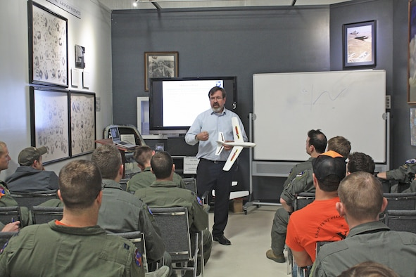 Dr. Chris Cotting, U.S. Air Force Test Pilot School master instructor of flying qualities, teaches a class at the Air Force Flight Test Museum April 4. (U.S. Air Force photo by Stephen K. Robinson)