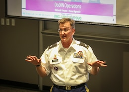 "Col. James ""Jim"" M. Chatfield, cyber director and deputy G-3 of operations for the 335th Signal Command (Theater) speaks to approximately 50 graduate students and Army Reserve Officer Training Corps cadets at the Scheller College of Business at the Georgia Institute of Technology in downtown Atlanta, Georgia, April 11.  Chatfield spent about 90 minutes discussing Army cyber capabilities and the future of cyber operations.  (Official U.S. Army Reserve Photo by Sgt. 1st Class Brent C. Powell)"