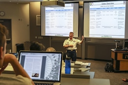 "Col. James ""Jim"" M. Chatfield, cyber director and deputy G-3 of operations for the 335th Signal Command (Theater) speaks to approximately 50 graduate students and Army Reserve Officer Training Corps cadets at the Scheller College of Business at the Georgia Institute of Technology in downtown Atlanta, Georgia April 11.  Chatfield spent about 90 minutes discussing Army cyber capabilities and the future of cyber operations.  (Official U.S. Army Reserve Photo by Sgt. 1st Class Brent C. Powell)"