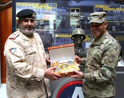 Lt. Gen. Michael Garrett, U.S. Army Central, commanding general, receives a gift from Maj. Gen. Khaled Saleh Al-Sabah, the Kuwait land forces commander dur-ing his visit to USARCENT headquarters at Shaw Air Force Base, S.C., April 5, 2017. During the visit USACRENT and key personnel met and discussed multi-ple topics to help build the long partnership between the two countries (U.S. Ar-my photo by Staff Sgt. Jared Crain)