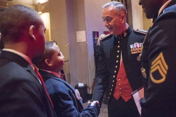 Marine Corps Gen. Joe Dunford, chairman of the Joint Chiefs of Staff, exchanges greetings with youth attending the Tragedy Assistance Program for Survivors 2017 Honor Guard Gala in Washington, D.C., April 12, 2017. Dunford served as the event's keynote speaker. DoD photo by Navy Petty Officer 2nd Class Dominique A. Pineiro