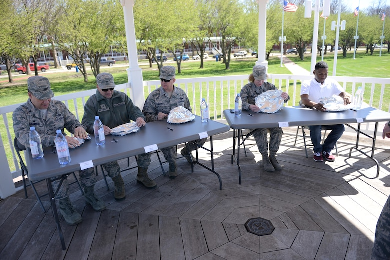 Judges sample four sets of appetizer, entrees and desserts made by four different teams on the parade field at Offutt Air Force Base, Neb., April 6, 2017 during the third annual Offutt Top Chef Grill Masters competition. Each team represented different ranks in the Air Force – junior enlisted, non-commissioned officers, senior non-commissioned officers and officers. (U.S. Air Force photo by Zachary Hada)