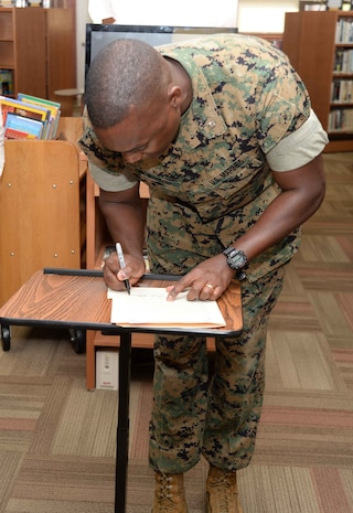 Library supporters and patrons celebrate the Grand Re-Opening of the newly-renovated Base Library and National Library Week at Marine Corps Logistics Base Albany, April 12. Lt. Col. Nathaniel Robinson, executive officer, MCLB Albany, read and signed the proclamation at the event.
