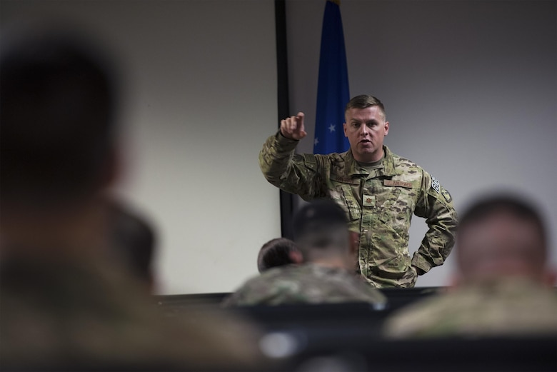 Maj. Michael Warren, 824th Base Defense Squadron commander, gives remarks during a deployment briefing prior to departure, April 12, 2017, at Moody Air Force Base, Ga. More than 100 Airmen from the 824th BDS, known as the 'Ghostwalkers,'deployed to Southwest Asia to provide fully-integrated, highly capable and responsive forces while safeguarding Expeditionary Air Force assets. (U.S. Air Force photo by Airman 1st Class Greg Nash)