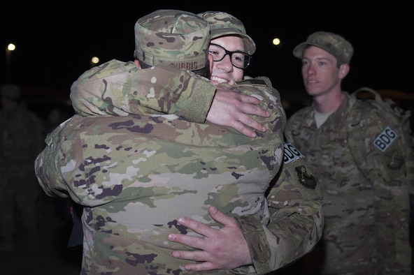 Senior Airman Erik Hjelden, 824th Base Defense Squadron fireteam member, embraces fellow 824th BDS member, Tech. Sgt. Chris Burris, prior to deploying, April 11, 2017, at Moody Air Force Base, Ga. More than 100 Airmen from the 824th BDS, known as the 'Ghostwalkers,'deployed to Southwest Asia to provide fully-integrated, highly capable and responsive forces while safeguarding Expeditionary Air Force assets. (U.S. Air Force photo by Airman 1st Class Greg Nash)