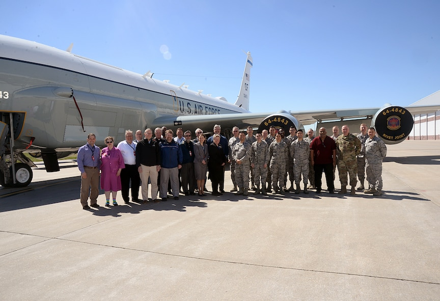 A group of more than 20 ministry leaders from across the Omaha metro area pose for a group photo outside of an RC-135V/W Rivet Joint during the 2017 Clergy Partnership Event here on April 6. The Offutt Chapel hosted the event with a goal of engaging local clergy from various faith groups and traditions in order to provide for the spiritual care of the base's military members and their families. (U.S. Air Force photo by Kendra Williams)