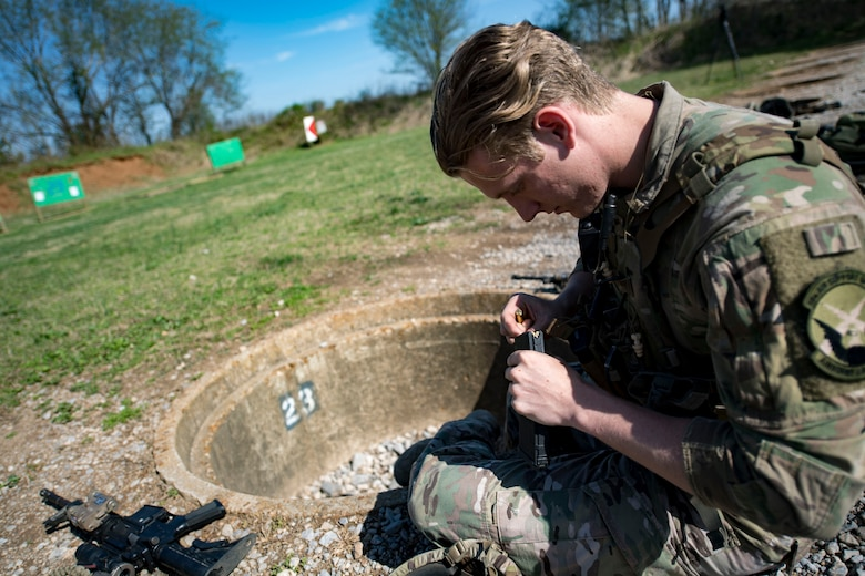 U.S. Air Force Senior Airman Brandon Malinowski, 19th Air Support Operations Squadron Tactical Air Control Party specialist loads ammo before attempting a German armed forces proficiency badge assessment, April 4, 2017, at Fort Campbell, Ky. To enhance their ability to work together in deployed locations, members of the German Air Force travelled to Fort Campbell to train and exercise with the 19th ASOS. While at Fort Campbell, The German Air Force members hosted a German armed forces proficiency assessment for Airmen consisting of shooting firearms, swimming, agility exercises and a rucksack march.
