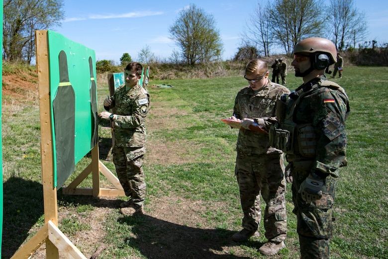 U.S. Air Force Staff Sgt. Christopher Torrez, left, 19th Air Support Operations Squadron Tactical Air Control Party specialist, counts the number of shots on target while 1st Lt. Megan Cox, 19th ASOS air liaison officer, and German Air Force Maj. Nader Samadi, German Air Ground Operations Squadron commander observe during the shooting portion of the a German armed forces proficiency assessment, April 4, 2017, at Fort Campbell, Ky. While at Fort Campbell, The German Air Force members hosted a German armed forces proficiency assessment for Airmen consisting of shooting firearms, swimming, agility exercises and a rucksack march.