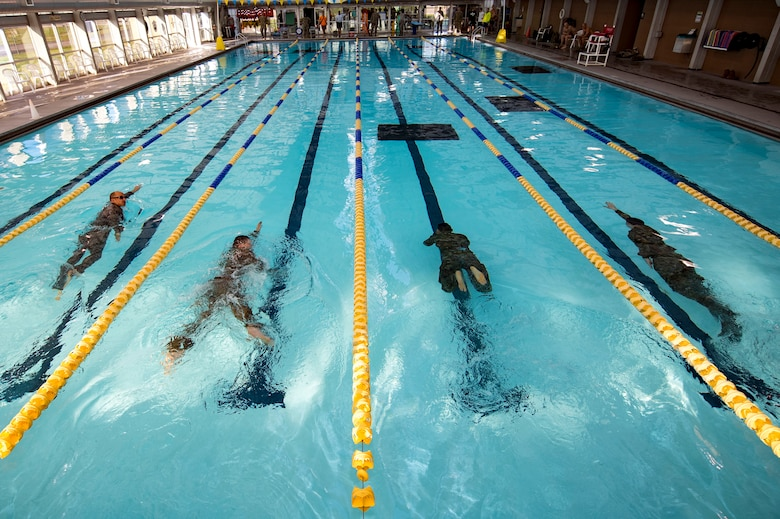 U.S. Air Force Airmen from the 19th Air Support Operations Squadron swim during a German armed forces proficiency assessment, April 5, 2017, at Fort Campbell, Ky. To enhance their ability to work together in deployed locations, members of the German Air Force travelled to Fort Campbell to train and exercise with the 19th ASOS. While at Fort Campbell, The German Air Force members hosted a German armed forces proficiency assessment for Airmen consisting of shooting firearms, swimming, agility exercises and a rucksack march.