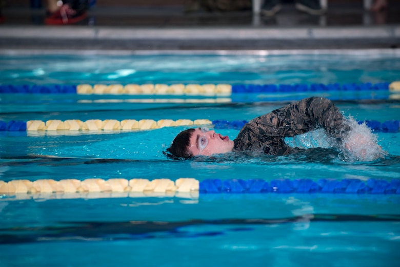 U.S. Air Force Airman 1st Class Aaron Gadd, 19th Air Support Operations Squadron Tactical Air Control Party specialist swims during a German armed forces proficiency assessment, April 5, 2017, at Fort Campbell, Ky. To enhance their ability to work together in deployed locations, members of the German Air Force travelled to Fort Campbell to train and exercise with the 19th ASOS. While at Fort Campbell, The German Air Force members hosted a German armed forces proficiency assessment for Airmen consisting of shooting firearms, swimming, agility exercises and a rucksack march.