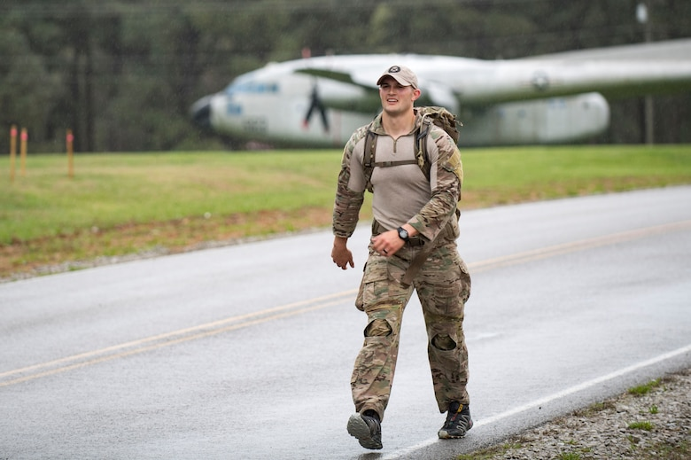 U.S. Air Force Staff Sgt. Kenneth Bartle, 19th Air Support Operations Squadron Tactical Air Control Party specialist finishes a rucksack march during a German armed forces proficiency assessment, April 6, 2017, at Fort Campbell, Ky. To enhance their ability to work together in deployed locations, members of the German Air Force travelled to Fort Campbell to train and exercise with the 19th ASOS. While at Fort Campbell, The German Air Force members hosted a German armed forces proficiency assessment for Airmen consisting of shooting firearms, swimming, agility exercises and a rucksack march.