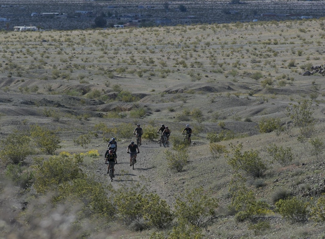 Participants navigate the Combat Center Bike Trail during the annual Earth Day Bike ride held aboard Marine Corps Air Ground Combat Center, Twentynine Palms, Calif., April 8, 2017. The 11-mile ride started at Range 100. (U.S. Marine Corps photo by Lance Cpl. Dave Flores)