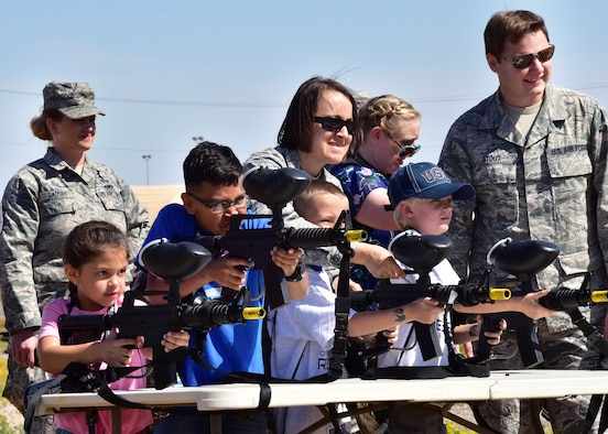 Airmen watch over children of members from the 944th Fighter Wing as they fire paint balls Apr. 1 during Operation Reserve Kids at Luke Air Force Base, Ariz. (U.S. Air Force photo by Tech. Sgt. Louis Vega Jr.)