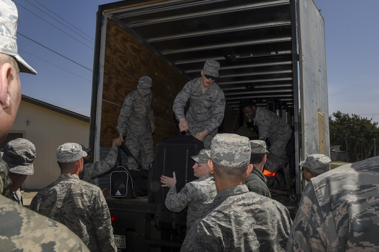 U.S. Air Force Airmen from Osan Air Base, Republic of Korea, receive their belongings following their arrival to Wolf Pack Park, an alternate lodging area at Kunsan Air Base, ROK, April 12, 2017. U.S. Air Force, Army, Marine Corps and Navy personnel and aircraft will train with the Republic of Korea Air Forces in the annual, bilateral training Exercise MAX THUNDER 17, which will be hosted at Kunsan Air Base, Republic of Korea, April 17-28, 2017. (U.S. Air Force Photo by Senior Airman Michael Hunsaker/Released)