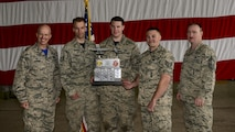 U.S. Air Force Staff Sgt. Jon Bybee, second from left, U.S. Air Force Senior Airman Charles Michel, and U.S. Air Force Staff Sgt. Andrew Finnegan, 177th Aircraft Maintenance Squadron weapons load crew members, pose with 51st Fighter Wing leadership after with the 51st Maintenance Group's quarterly weapons load crew competition at Osan Air Base, Republic of Korea, April 14, 2017. The Airmen, who are deployed to Osan from the New Jersey Air National Guard's 177th Fighter Wing, beat the top weapons load crew from the 36th and 25th Aircraft Maintenance Units. (U.S. Air Force photo by Staff Sgt. Victor J. Caputo)