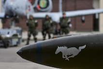 A 25th Aircraft Maintenance Unit weapons load crew waits near their aircraft before the quarterly 51st Maintenance Group weapons load crew competition at Osan Air Base, Republic of Korea, April 14, 2017. The top weapons load crew from the two AMUs compete every quarter for the number one spot, and this quarter were joined by a New Jersey Air National Guard 177th Aircraft Maintenance Squadron crew. (U.S. Air Force photo by Staff Sgt. Victor J. Caputo)