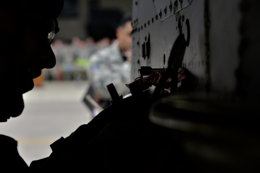 U.S. Air Force Senior Airman Cesar Otero-Moya, 25th Aircraft Maintenance Unit 2-man, tightens a GBU-12 Paveway II during a quarterly 51st Maintenance Group weapons load competition at Osan Air Base, Republic of Korea, April 14, 2017. The GBU-12 Paveway II is an American aerial laser guided bomb and is considered a general-purpose warhead. (U.S. Air Force photo by Airman 1st Class Gwendalyn Smith)
