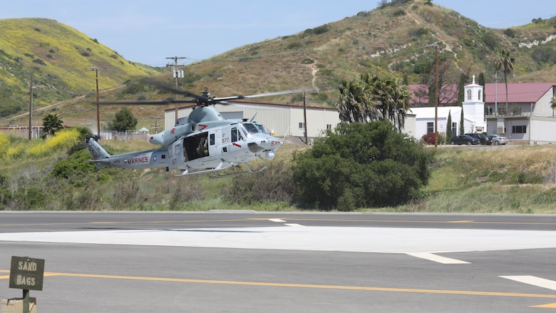 A UH-1Y Huey with Marine Light Attack Helicopter Training Squadron 303 lands during a demonstration for the School of Infantry West at Marine Corps Base Camp Pendleton, Calif., April 11. Marines with HMLAT-303 conducted basic flight maneuvers during the demonstration to build cohesion between air and ground Marines.