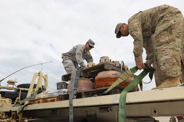 Army Spc. Dartanian Pina and Staff Sgt. Nicholas San Miguel from the 115th BSB, 1st Cavalry Division,unload a pallet of unserviceable parts for recycling to contribute to the 200,000 pounds collected by Fort Hood Recycle.