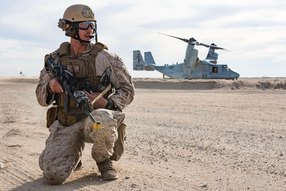 Staff Sgt. Nick Graham, 1st Battalion, 7th Marine Regiment, Special Purpose Marine Air-Ground Task Force-Crisis Response-Central Command, posts security during a mission exercising the tactical recovery of aircraft and personnel at an undisclosed location in Southwest Asia, April 5, 2017. The TRAP capability provided by the Marines enables pilots supporting Operation Inherent Resolve to fly with the confidence of knowing rescue personnel are on standby. (U.S. Air Force photo/Master Sgt. Benjamin Wilson)(Released)