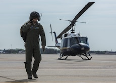 Capt. Jason Pettengill, 11th Wing executive officer, walks past a 1st Helicopter Squadron UH-1N Iroquois after a flight at Joint Base Andrews, Md., April 13, 2017. The 1st HS played a role in the F-16 Fighting Falcon crash six miles southwest of JBA by recovering a downed pilot, who sustained non-life threatening injuries. (U.S. Air Force photo by Senior Airman Jordyn Fetter)