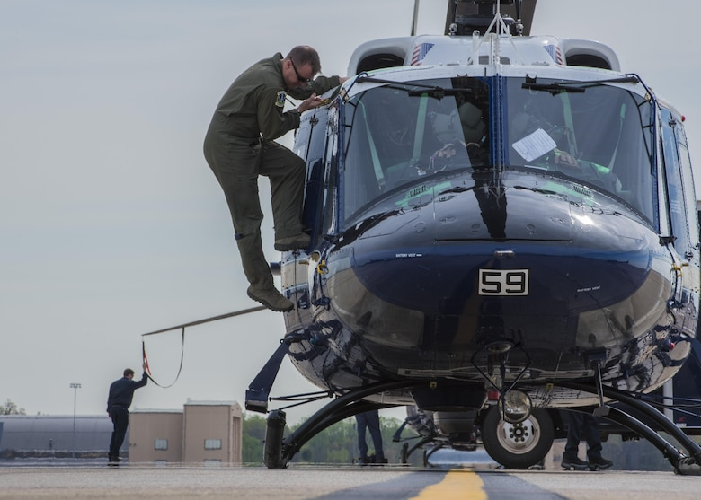 An UH-1N Iroquois pilot climbs off a helicopter after a flight at Joint Base Andrews, Md., April 13, 2017. The aircraft belong to the 1st Helicopter Squadron, which conducts high-priority airlift missions and provides contingency response in the National Capitol Region. The squadron performed a medical evacuation of a downed pilot during the F-16 Fighting Falcon crash incident April 5.  (U.S. Air Force photo by Senior Airman Jordyn Fetter)