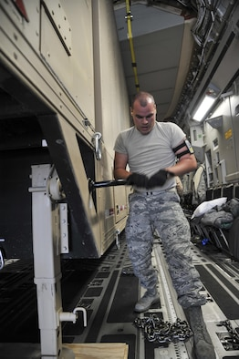 Senior Airman Robert Jared, 377th Logistics Readiness Squadron air terminal specialist, stabilizes the Universal Ground Nuclear Detonation Detection Terminal trailer on a C-17 Globemaster III at Kirtland Air Force Base, March 21. Loading is a slow and careful process to assure that the aircraft and the asset remain as unharmed as possible. (U.S. Air Force photo by Senior Airman Nigel Sandridge)