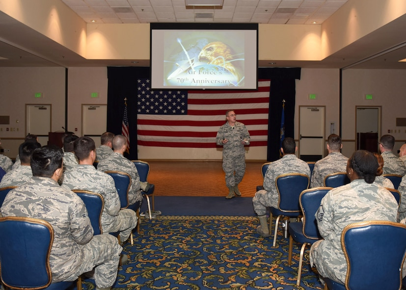 Col. J. Christopher Moss, 30th Space Wing commander, speaks to Airmen during an All-Call, April 11, 2017, Vandenberg Air Force Base, Calif. Accompanied by Chief Master Sgt. Robert Bedell, 30th SW command chief, the duo used the opportunity to communicate directly with Team V Airmen and praise them for their numerous accolades earned in 2016. (U.S. Air Force photo by Senior Airman Kyla Gifford/Released)