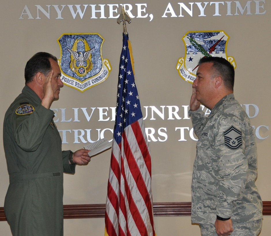 Senior Master Sgt. Jon Rousseaux receives his reenlistment oath from Col. Michael Vanzo, 340 FTG Director of Operations, Feb. 3, 2017. (Photo by Janis El Shabazz, 340 FTG Public Affairs).