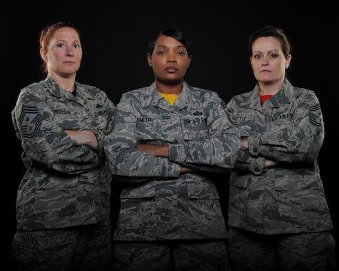 From left to right, U.S. Air Force Chief Master Sgt. Lisa Furgeson, the 442d Fighter Wing command chief, Chief Master Sgt. Melvina Smith, the 509th Bomb Wing command chief, and Chief Master Sgt. Jessica Settle, the 131st Bomb Wing command chief, are photographed for the Whiteman Warrior. This is the first time Team Whiteman has had female Airmen hold the position of command chief in all three wings at the same time. (U.S. Air Force photo by Airman 1st Class Jazmin Smith)