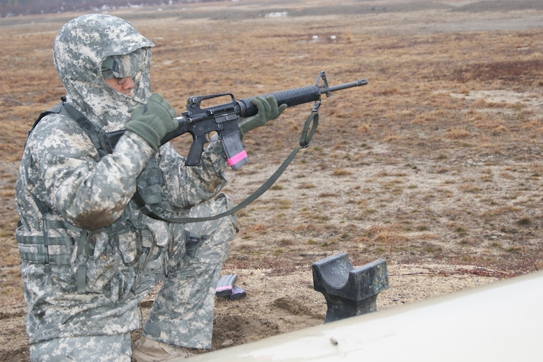 Competitor Staff Sgt. Raymond Velez, Jr., of the 94th Training Division, chambers a round in his M16-A2 rifle at the weapons qualification range at Fort Devens, Massachusetts, April 4, 2017, as part of the 2017 Joint 80th Training Command and 99th Regional Support Command Best Warrior Competition.