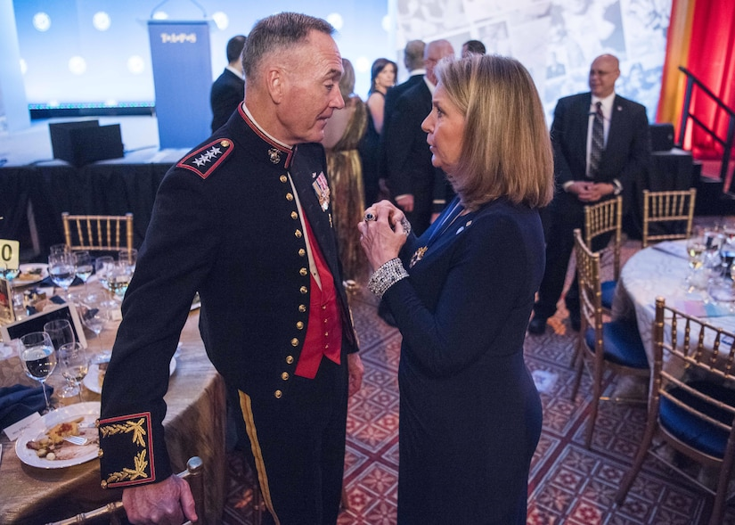 Marine Corps Gen. Joe Dunford, chairman of the Joint Chiefs of Staff, speaks with Bonnie Carroll, TAPS president and founder during the Tragedy Assistance Program for Survivors 2017 Honor Guard Gala in Washington, D.C., April 12, 2017. DoD photo by Navy Petty Officer 2nd Class Dominique Pineiro