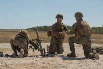 A Marine hands a fellow mortarman a 60mm mortar during a live-fire range at Camp Lejeune, N.C., April 11, 2017. Marines participated in the training to familiarize themselves with current weapon systems they use as infantry Marines. The Marines are with Golf Company, 2nd Battalion, 2nd Marine Regiment. (U.S. Marine Corps photo by Pfc. Abrey D. Liggins)