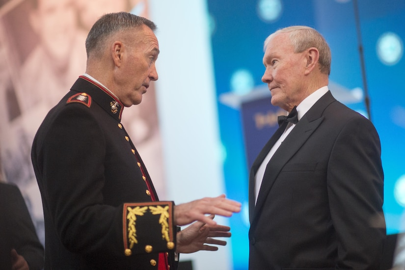 Marine Corps Gen. Joe Dunford, the chairman of the Joint Chiefs of Staff, speaks with his immediate predecessor as chairman, retired Army Gen. Martin E. Dempsey, who is now the president of USA Basketball, during the Tragedy Assistance Program for Survivors Honor Guard Gala at the National Building Museum April 12, 2017. DoD photo by Navy Petty Officer 2nd Class Dominique Pineiro
