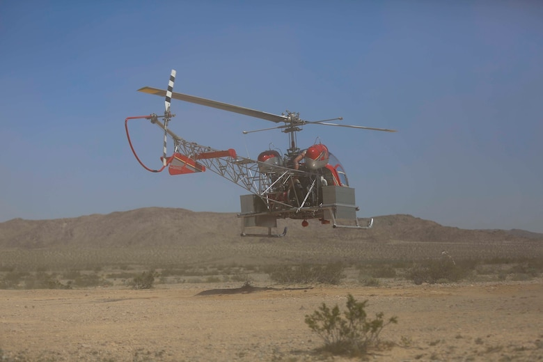 A helicopter lands to pick up desert tortoises and deliver them to a recipient site during the Desert Tortoise translocation, April 10, 2017, which was facilitated by the Marine Corps Air Ground Combat Center, Twentynine Palms, Calif. The translocation, in accordance with the U.S. Fish and Wildlife Service-signed Biological Opinion, serves as a negotiated mitigation to support a congressionally mandated land expansion which, will afford the Combat Center the ability to conduct Large Scale Exercise training of a Marine Expeditionary Brigade-level force. (U.S. Marine Corps photo by Cpl. Medina Ayala-Lo)