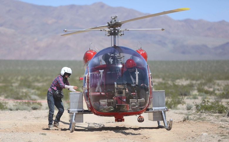 A biologist with Natural Resources and Environmental Affairs places desert tortoises into a carrying case on a helicopter during the Desert Tortoise translocation, April 10, 2017, which was facilitated by the Marine Corps Air Ground Combat Center, Twentynine Palms, Calif. The translocation, in accordance with the U.S. Fish and Wildlife Service-signed Biological Opinion, serves as a negotiated mitigation to support a congressionally mandated land expansion which, will afford the Combat Center the ability to conduct Large Scale Exercise training of a Marine Expeditionary Brigade-level force. (U.S. Marine Corps photo by Cpl. Medina Ayala-Lo)