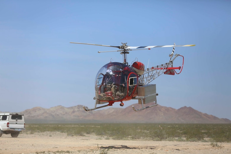 A helicopter transfers desert tortoises to a recipient site via helicopter during the Desert Tortoise translocation, April 10, 2017, which was facilitated by the Marine Corps Air Ground Combat Center, Twentynine Palms, Calif. The translocation, in accordance with the U.S. Fish and Wildlife Service-signed Biological Opinion, serves as a negotiated mitigation to support a congressionally mandated land expansion which, will afford the Combat Center the ability to conduct Large Scale Exercise training of a Marine Expeditionary Brigade-level force. (U.S. Marine Corps photo by Cpl. Medina Ayala-Lo)