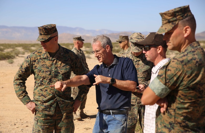 Combat Center Commanding General, Brig. Gen. William F. Mullen III, asks Dr. Brian Henen, base ecologist, Natural Resources and Environmental Affairs, questions about the Desert Tortoise translocation facilitated by the Marine Corps Air Ground Combat Center, Twentynine Palms, Calif., April 12, 2017. The translocation, in accordance with the U.S. Fish and Wildlife Service-signed Biological Opinion, serves as a negotiated mitigation to support a congressionally mandated land expansion which, will afford the Combat Center the ability to conduct Large Scale Exercise training of a Marine Expeditionary Brigade-level force. (U.S. Marine Corps photo by Cpl. Medina Ayala-Lo)