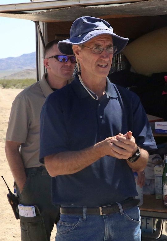 Dr. Brian Henen, base ecologist, Natural Resources and Environmental Affairs, answers media member's questions during the Desert Tortoise translocation, April 12, 2017, which was facilitated by the Marine Corps Air Ground Combat Center, Twentynine Palms, Calif. The translocation, in accordance with the U.S. Fish and Wildlife Service-signed Biological Opinion, serves as a negotiated mitigation to support a congressionally mandated land expansion which, will afford the Combat Center the ability to conduct Large Scale Exercise training of a Marine Expeditionary Brigade-level force. (U.S. Marine Corps photo by Cpl. Medina Ayala-Lo)